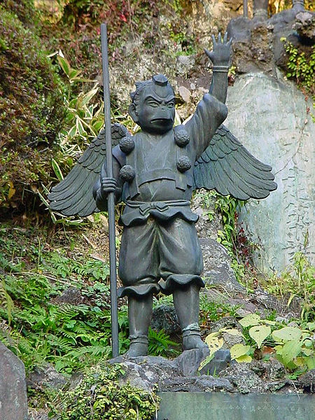 A statue of a Tengu dressed as an ascetic mystic on a mountain pilgrimage.  Source: Christian Bauer via Wikimedia.