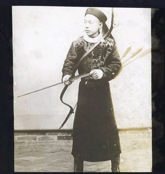 """""""Manchu Nobleman with Bow."""" by Michel De Maynard (probably pre 1911).  Source: Getty Archive."""