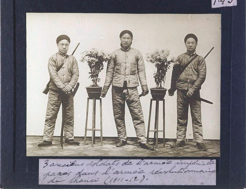 """""""Three Soldiers from the old Imperial Army who have jointed the Revolutionary Army."""" by Fr. Michel De Maynard.  Source: Getty Archive."""