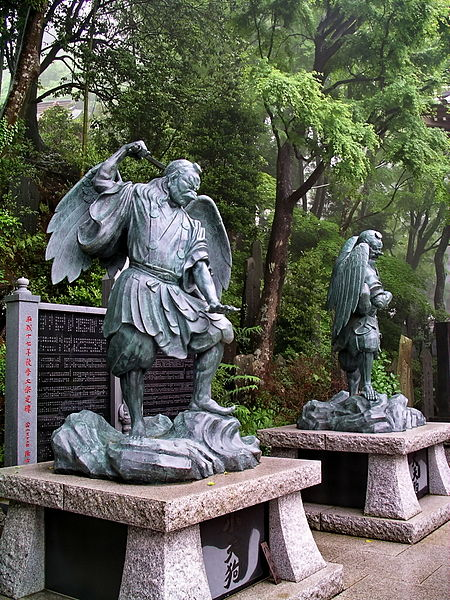 Statues of Tengu, a Japanese mountain demon sometimes associated with the transmission of secret martial knowledge, on My. Takao.  Source: Wikimedia.