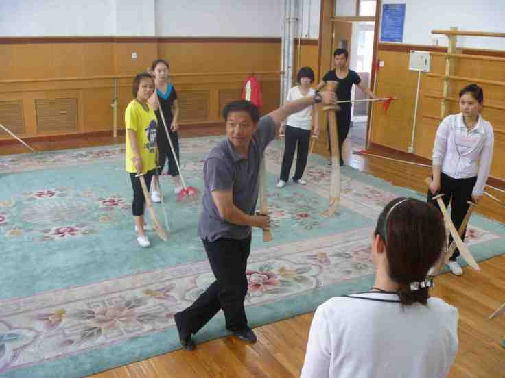 Prof. Lu teaching Shuang Dao.  Source: Property of Daniel Mroz.