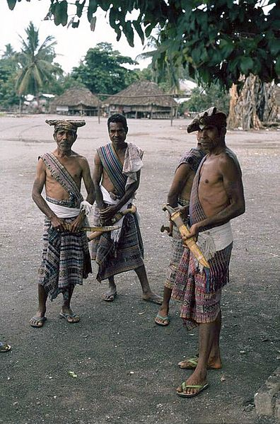 Villagers Displaying Traditional Weapons in East Timor.  Source: Wikimedia.
