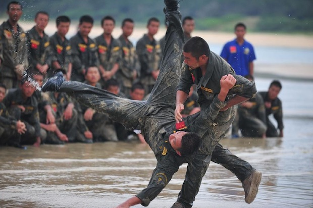 A private bodyguard training program in Sanya, Hainan, held by Ginghis Security Academy.  Source: Xinhua.
