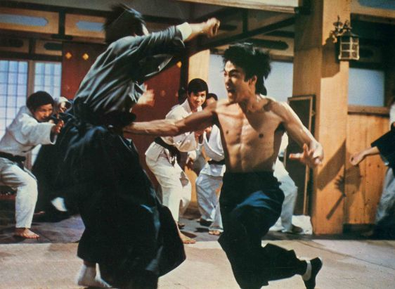 "Bruce Lee fighting a room full of Japanese martial arts students in ""Fists of Fury."" This scene later inspired the ""Dojo Fight"" in Wilson Ip's 2008 Ip Man biopic."