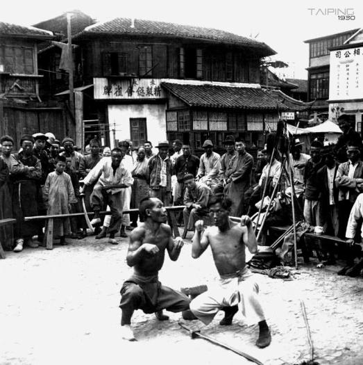 """Monkey Boxers"" performing in a public market in Shanghai circa 1930.  Source: Taiping Institute."
