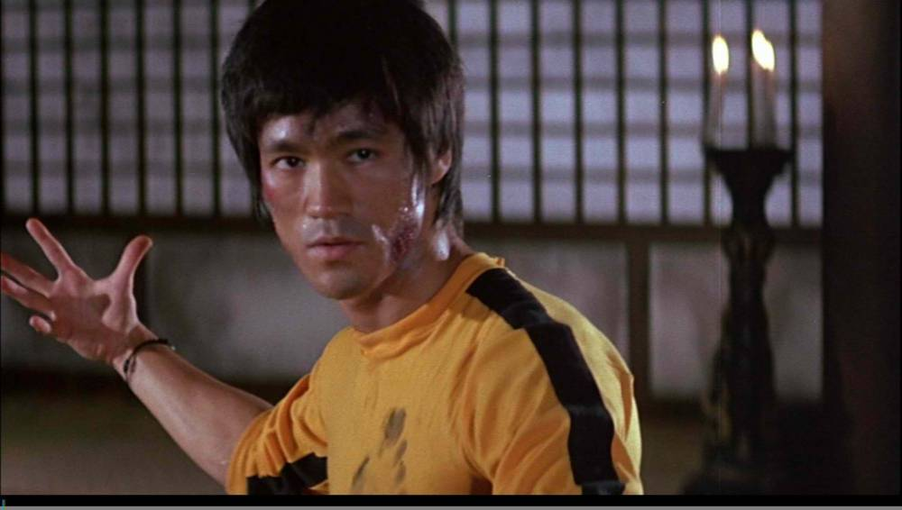 "Bruce Lee wearing his iconic yellow track suit in ""Game of Death."""