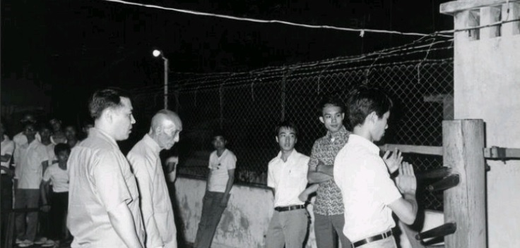 Ip Man visits Ho Ka Ming on a rooftop in Macau.  Source: I am unsure where this photo was first published.  If anyone knows drop me a line.
