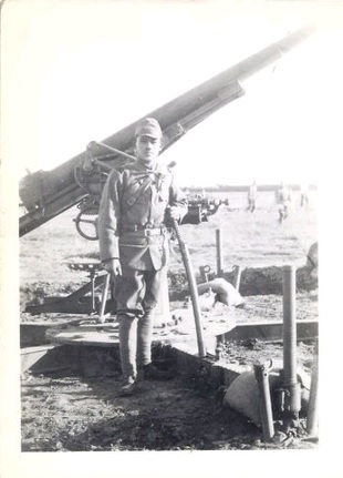 An image of a Japanese soldier holding a Gunto in China during WWII.  This image was in the photo album along with the record of confiscated weapons below.  Source: Author's personal collection.