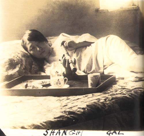 A Woman Smoking Opium in Shanghai.  Source: Unkown.