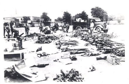 A yard in which captured Chinese weapons and material is being sorted by Japanese soldiers.  Source: Author's personal collection.