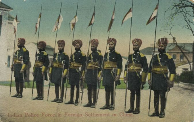 """Indian"" police officers in Shanghai.  Source: Vintage Postcard."