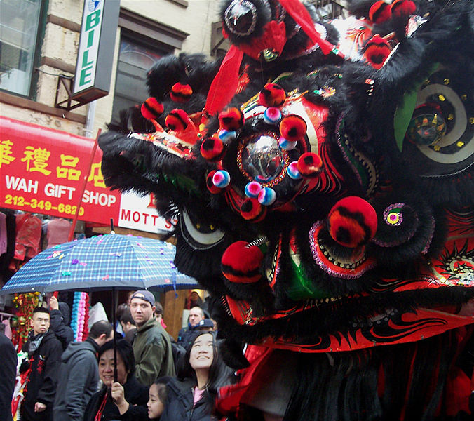 A Lion Dance performance in NYC's Chinatown.  Source: Wikimedia.