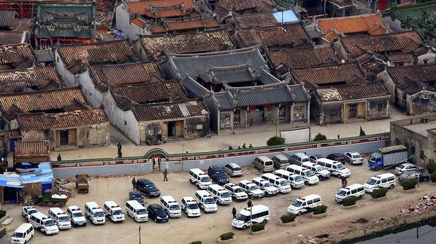Police vehicles parked outside of the walls of    Source: Reuters.