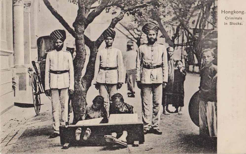 """Indian"" Police Officers in Hong Kong.  This postcard probably dates from the middle of the 1920s, though the image could be a few years older than that.  Source: Vintage Postcard, author's personal collection."
