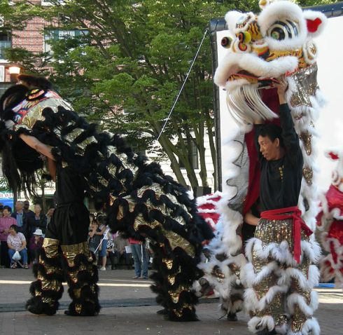 Lion Dancers in Seattle, 2007.  Source: Wikimedia.  Photo by Joe Mabel.