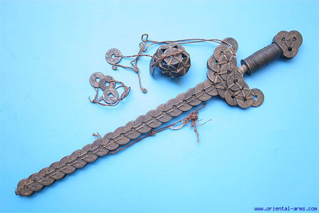 A late 19th Century Guardian Sword made of period coins.  Such talisman were used as protective magical weapons.  Source: