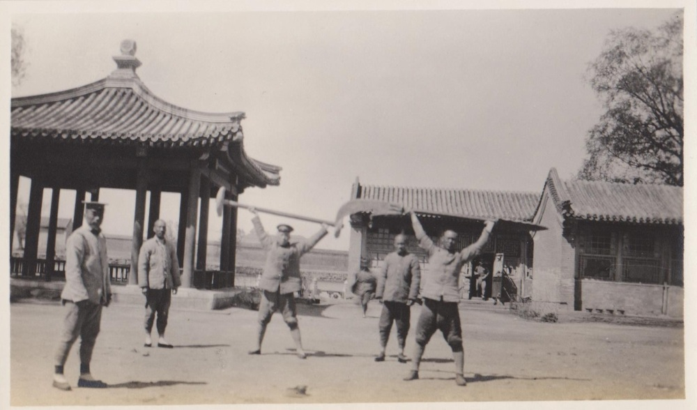 A vintage photograph showing Republic era army troops at the Winter Palace in Beijing posing with Stone Wheels and a Wukedao (Heavy Knife). Source: Author's personal collection.