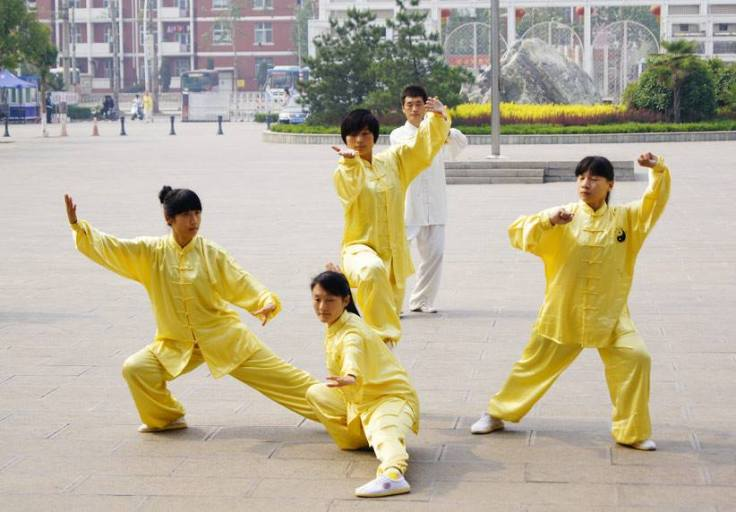 University students who are taking classes on the traditional martial arts in China.