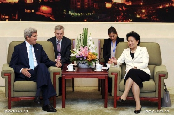 Kung Fu diplomacy in action.  Chinese Vice Premier Liu Yandong (R) meets with U.S. Secretary of State John Kerry after they jointly hosted the Fifth Round of the China-U.S. High-Level Consultation on People-to-People Exchange (CPE) in Beijing, capital of China, July 10, 2014. (Xinhua/Zhang Duo)