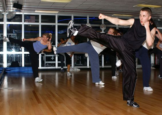 A pretty typical looking kickboxing class.  Source: Wikimedia.