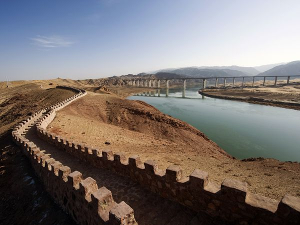 The Yellow River running along side the great wall of China.  Frequent floods of this silt laden waterway both impoverished sections of Shandong and contributed to the rise of banditry and disorder.