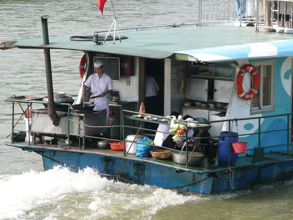 Preparing lunch on a tourist boat on the Pearl River.  Source: Wikimedia.