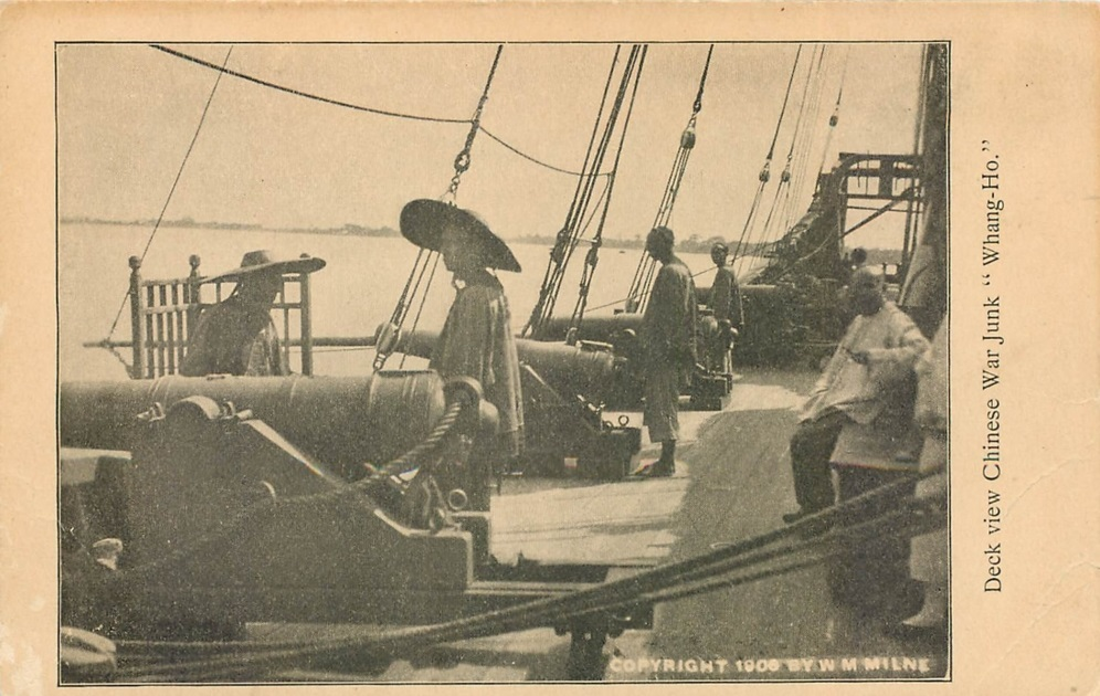 Vintage postcard showing Chinese sailors at the cannons of the War Junk Whang Ho. Note Milne's copyright on the lower right.  Source: Author's personal collection.