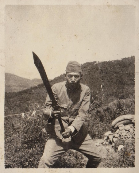 A captured Chinese dadao being held by a Japanese soldier. Note the unique saw back blade. Source: Author's Personal Collection.