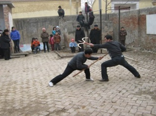 Mei Boxers weapons practice in Hou Zhuzhai Village (Puyang, Henan).  Source: Personal Collection of Prof. Thomas Green.