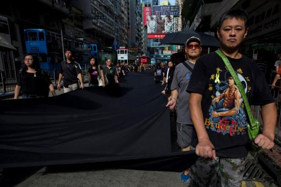 An Occupy Central Protester wears a Bruce Lee shirt.  Source: http://www.reuters.com