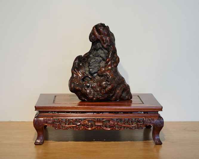 A viewing stone said to look like the famous monk Bodhidharma (often associated with the Shaolin Temple).  Stones like this are collected and appreciated by individuals in both China and Japan.  This particular specimin is located in the National Bonasai and Penjing Museum in Washington D.C.  Source: Photo by Sage Ross, Wikimedia.