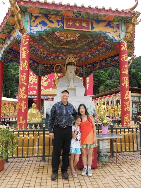 Dr. Amos, wife Yukari and daughter Himiko, at the 10,000 Buddhas Temple in Hong Kong, standing in front of Guan Yin (Goddess of Mercy), one of the gods worshipped by our martial house.  Source: Amos' personal collection.