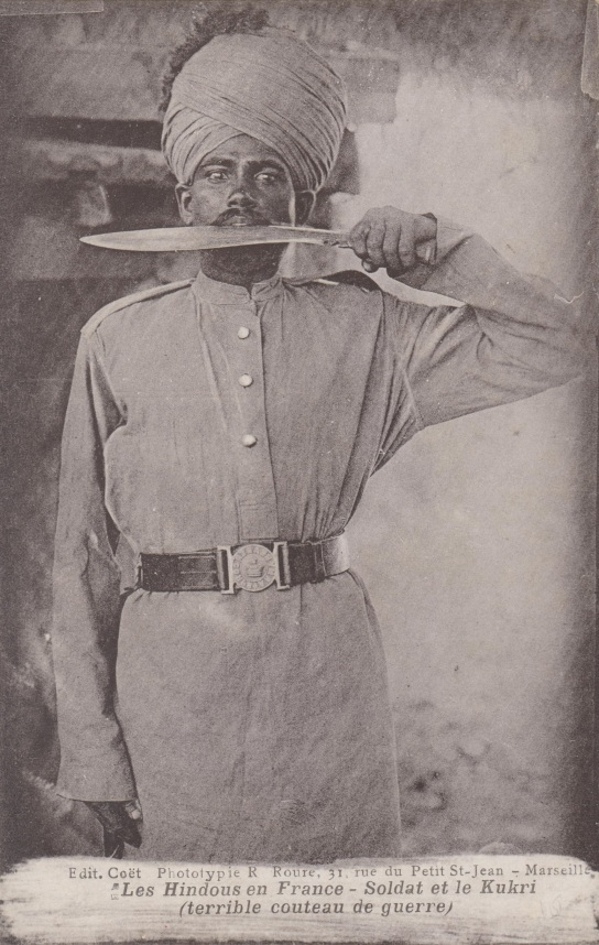 "French postcard sold in Marseia circa 1915 showing a ""Hindu"" member of the Indian Army Bearer Corp (note the belt buckle) holding a kukri.  Source: Author's personal collection."