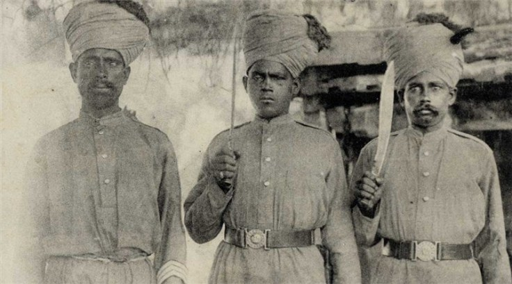 "Another photograph, often labeled ""Indian Troops in France"" which features the same individual.  You can see the profile of his knife blade better in this shot, strongly suggesting that his weapon is the variant of the MKI service kukri that was produced at Fort William.  Source: Old Indian Photos (Public Domain)."