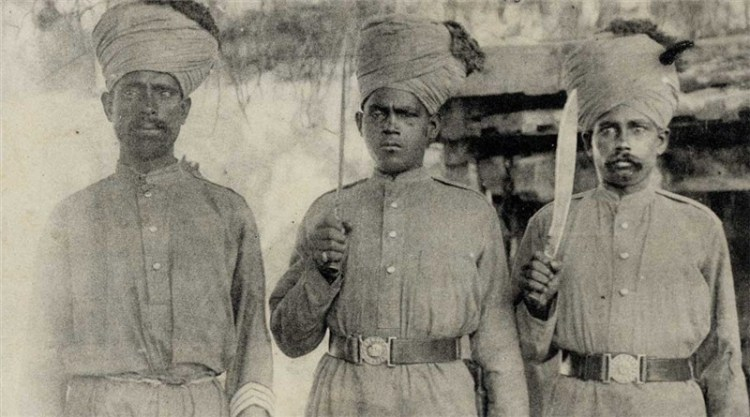 """Another photograph, often labeled """"Indian Troops in France"""" which features the same individual.  You can see the profile of his knife blade better in this shot, strongly suggesting that his weapon is the variant of the MKI service kukri that was produced at Fort William.  Source: Old Indian Photos (Public Domain)."""