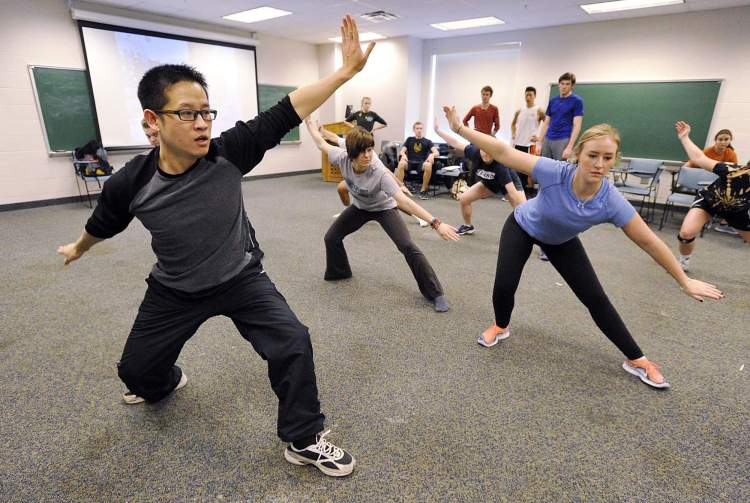 Daliang Wang, 38, left, an associate professor of Chinese at Mercyhurst University, leads students in a martial-arts class at the Erie school on Jan. 14. Freshman Samantha Fieseler, 18, is at right. GREG WOHLFORD/ERIE TIMES-NEWS