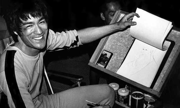 Bruce Lee sketching on the set for Game of Death. Photograph: Bruce Lee Estate.  Source: The Guardian.