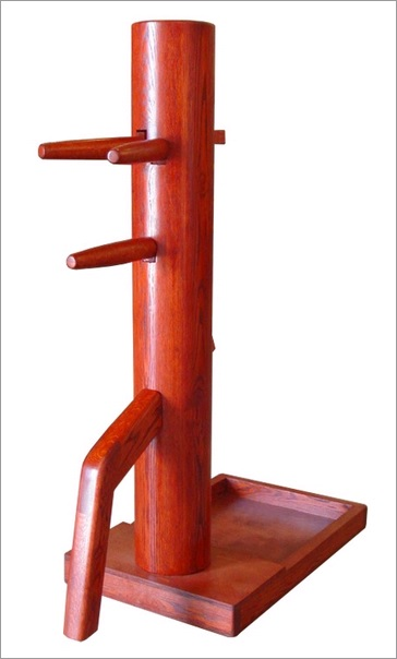 This dummy has a laminated wooden body and is mounted on a freestanding base. This is currently the most commonly purchased style of (full sized) wooden dummy. Photo: Everything Wing Chun