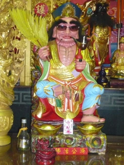 A modern votive statue of Ji Gong.  I love the updated look with the Sunglasses.