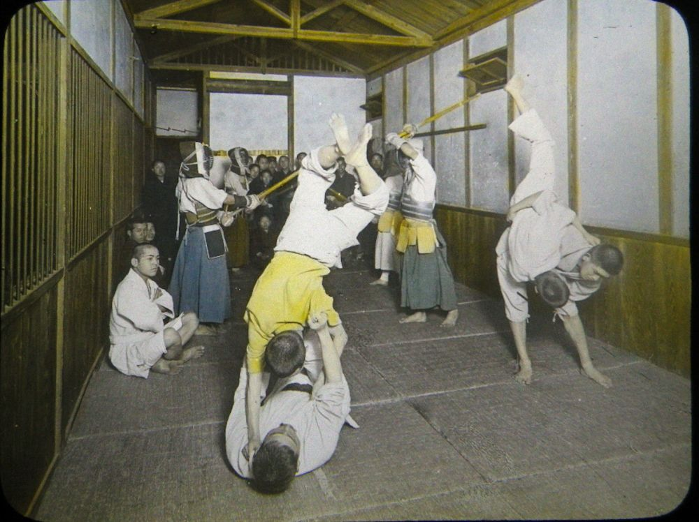 A hand colored magic lantern slide, produced in Japan, showing both Judo and Kendo.  Source: Author's Personal Collection.