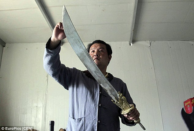 Jia Huaijin inspecting an unmounted blade.  Source: dailymail.com