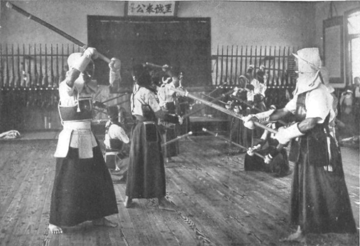 Kendo club at a Japanese Agricultural School during the 1920s. Note the rifles along the back wall. Source: wikimedia.