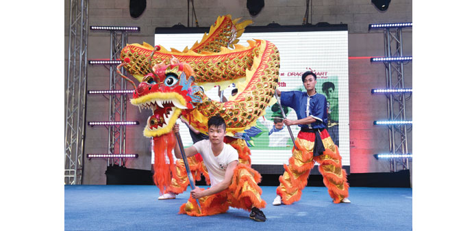 A Chinese martial arts and dragon dance display in Qatar.  Source: http://www.gulf-times.com