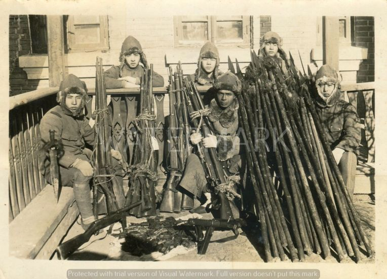 Japanese soldiers with captured Chinese spears and other weapons.  Original photographer unkown.  Source: Photo album of a Japanese soldier.