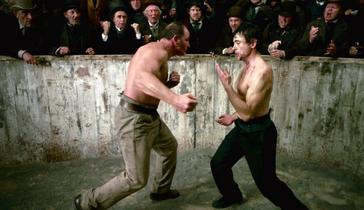 A great example of a close range fight scene from the 2009 Sherlock Holmes.  This scene has always fascinated me as it attempts seems to both educate the viewer about technical aspects of the fight that is unfolding through a discussion of Holmes' personality.