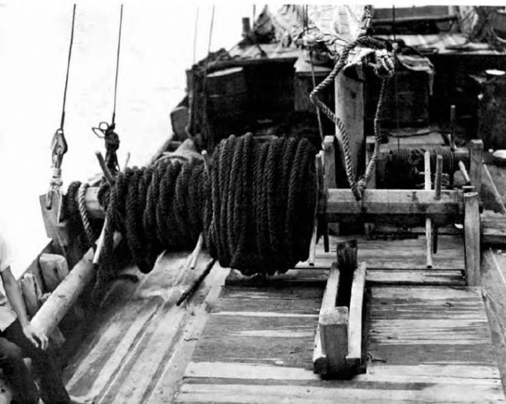 A windlass on the deck of a Vietnamese Junk loaded with rope.