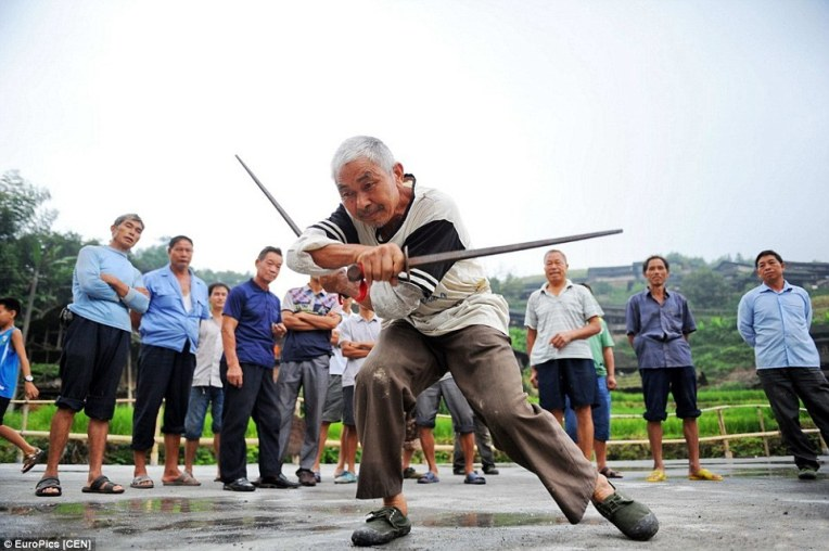 An older resident of the same village demonstrating a form with dual iron whips. Source: http://www.dailymail.co.uk