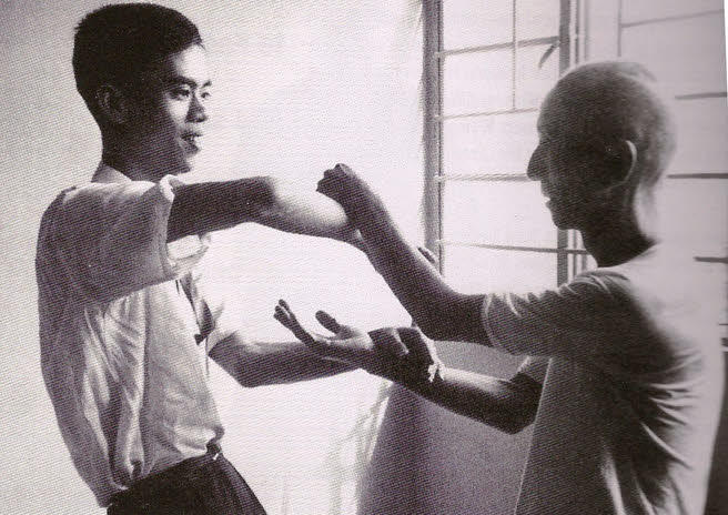 Ip Man practices Chi Sao With Moy Yat.