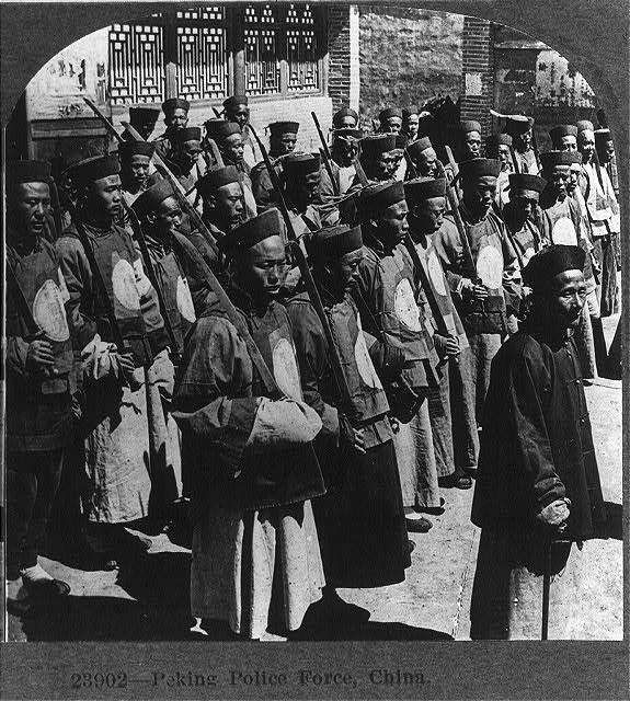 """Peking Police Force"" (of the older Qing variety). Keystone Viewing Company, 1919. Source: Digital Collection of the Library of Congress (Public Domain). Given the popularity of these slides, this was probably one of the most widely distributed images of traditional Chinese swords in the west during the 1920s. Unfortunately I have yet to find a copy of this side in decent condition to add to my own collection. Note the variety of blade profiles apparent in this photo."