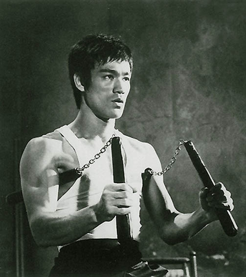 Bruce Lee with his favorite onscreen weapon.